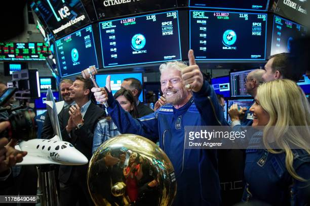 Sir Richard Branson, Founder of Virgin Galactic, gives the thumbs up after ringing a ceremonial bell on the floor of the New York Stock Exchange to...