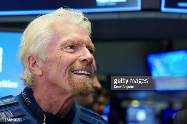 Sir Richard Branson, Founder of Virgin Galactic, looks on before ringing a ceremonial bell on the floor of the New York Stock Exchange to promote the...