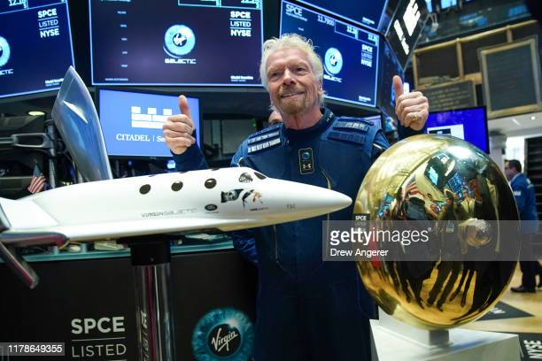 Sir Richard Branson, Founder of Virgin Galactic, poses for photographs before ringing a ceremonial bell on the floor of the New York Stock Exchange...