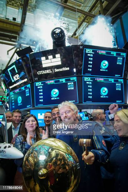 Sir Richard Branson, Founder of Virgin Galactic, rings a ceremonial bell on the floor of the New York Stock Exchange to promote the first day of...