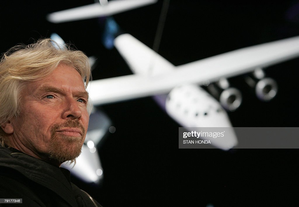 Sir Richard Branson, founder of Virgin Galactic, with a scale model of the Spaceship Two attached to the White Knight carrier aircraft, 23 January 2008, at the America Museum of Natural History in New York. Virgin Galactic will attempt to launch paying customers into sub-orbital space flights with the Spaceship Two. AFP PHOTO/Stan HONDA