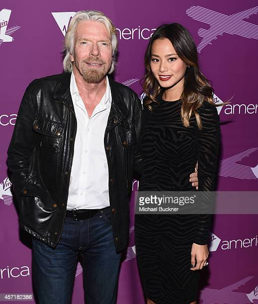 Sir Richard Branson Founder Virgin Group and actress Jamie Chung attend the Virgin America Dallas Love Field Launch Celebration at the House of Blues...
