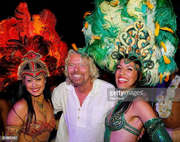 """Sir Richard Branson interacts with entertainers during the """"Branson By The Pool"""" function, as part of a series of fundraising events for the Strike A..."""