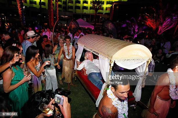 """Sir Richard Branson is carried on his arrival during the """"Branson By The Pool"""" function, as part of a series of fundraising events for the Strike A..."""