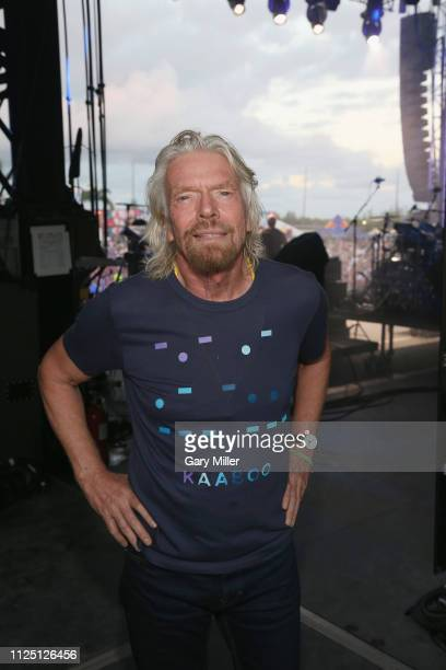 Sir Richard Branson joins Flo Rida on stage during the sold out inaugural KAABOO Cayman Festival at Seven Mile Beach on February 15, 2019 in Grand...