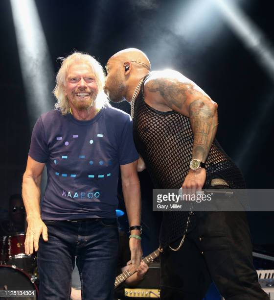 Sir Richard Branson joins Flo Rida on stage during the sold out inaugural KAABOO Cayman Festival at Seven Mile Beach on February 15 2019 in Grand...