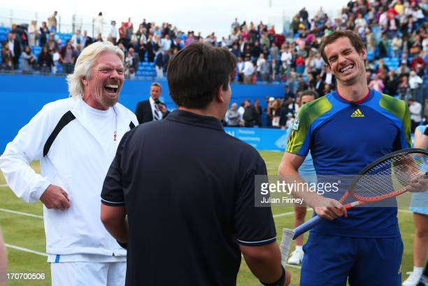 Sir Richard Branson, Michael McIntyre and Andy Murray share a joke during the Rally Against Cancer charity match on day seven of the AEGON...