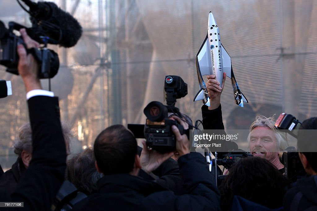 Sir Richard Branson of Virgin Atlantic holds up a model of a spaceship unveiled at a news conference Wednesday January 23, 2008 in New York City. Branson hopes the spaceship will be the first to ferry paying passengers into space on a regular schedule. Branson's Virgin Galactic is one of several commercial enterprises currently competing to offer flights to space. Looking to commence the program latter this year, about 200 people have already signed up for the rides, which cost about $200,000 per person.
