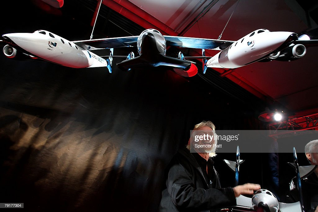 Sir Richard Branson of Virgin Atlantic stands under a model of a spaceship unveiled at a news conference January 23, 2008 in New York City. Branson hopes the spaceship will be the first to ferry paying passengers into space on a regular schedule. Branson's Virgin Galactic is one of several commercial enterprises currently competing to offer flights to space. Looking to commence the program latter this year, about 200 people have already signed up for the rides, which cost about $200,000 per person.