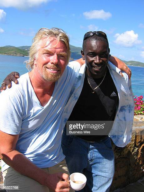 Sir Richard Branson pictured with Elvis lead singer of ELVIS WHITE at Necker Island in the British Virgin Islands