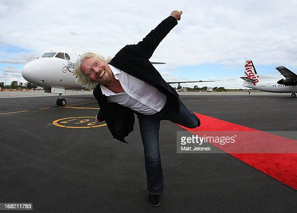 Sir Richard Branson poses in front of an aircraft at Perth Airport on May 7 2013 in Perth Australia Virgin Australia purchased Perthbased regional...