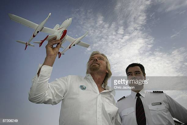 Sir Richard Branson poses with Alex Tai and a model of Spaceship One after a Press conference for Virgins new service Virgin Galactic at Emirates...