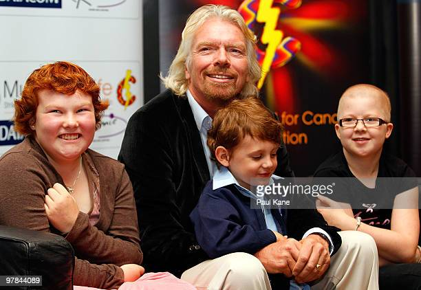 Sir Richard Branson poses with children who are being treated with cancer prior to a breakfast function, as part of a series of fundraising events...