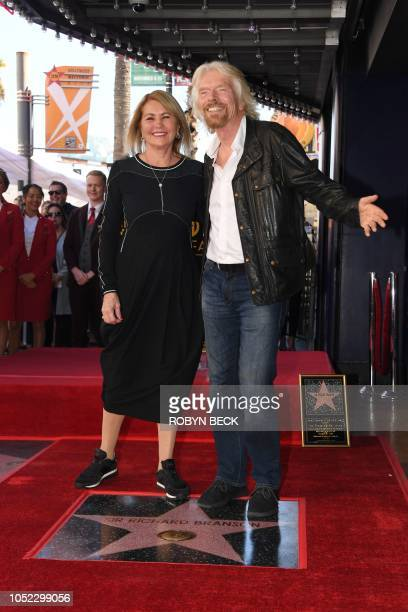 Sir Richard Branson poses with his wife Joan Templeman on his star at his Hollywood Walk of Fame star unveiling ceremony, October 16, 2018 in...