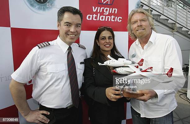 Sir Richard Branson poses with Pilot Alex Tai and Namira Salim the first Dubai founder Astronaut with a model of Spaceship One after a Press...