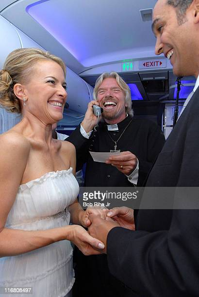 Sir Richard Branson presides over the inflight wedding ceremony of Dimitrios Papadogonas and his fiancee Coco Jones from San Francisco CA while...