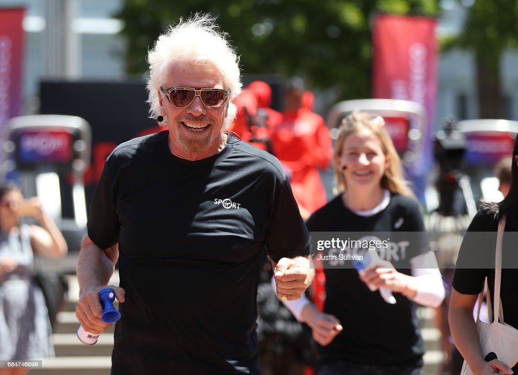 Sir Richard Branson runs during a news conference to announce the launch of Virgin Sport on May 18, 2017 in San Francisco, California. Virgin Group founder Sir Richard Branson announced Virgin Sport San Francisco, a half marathon run and fitness festival that is scheduled for October 14.