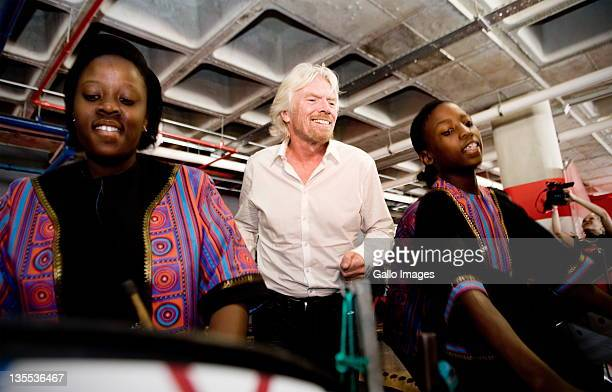 Sir Richard Branson smiles at the grand opening of Maponya Mall's Virgin Active on December 10 2011 in Soweto South Africa