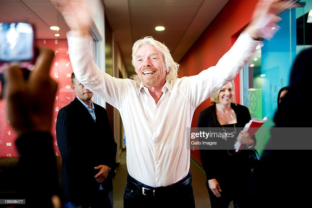 Sir Richard Branson smiles at the grand opening of Maponya