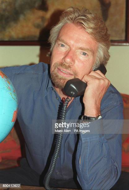 Sir Richard Branson speaks to inventor Trevor Baylis using the world's first shoes made for talking The shoes were hailed a success when Mr Baylis...