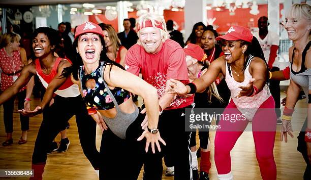 Sir Richard Branson takes part in an aerobics class at the grand opening of Maponya Mall's Virgin Active on December 10 2011 in Soweto South Africa