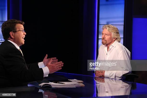"Sir Richard Branson talks with host Neil Cavuto on ""Cavuto"" on FOX Business Network at FOX Studios on September 23, 2014 in New York City."
