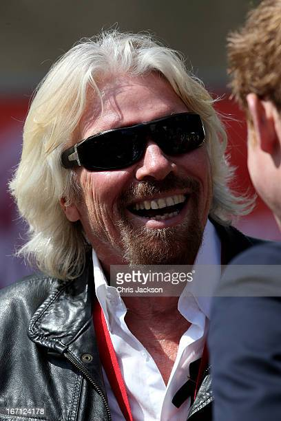 Sir Richard Branson the chairman of Virgin Group chats with Prince Harry at the finish the Virgin London Marathon 2013 on April 21 2013 in London...