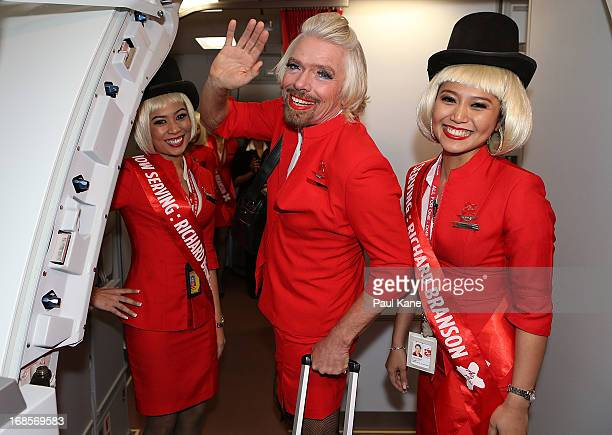 Sir Richard Branson waves farewell prior to his flight to Kuala Lumpur at Perth International Airport on May 12 2013 in Perth Australia Sir Richard...