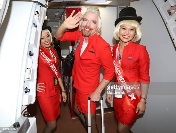 Sir Richard Branson with AirAsia Stewardess' at Perth International Airport on May 12 2013 in Perth Australia Branson shaved his legs wore make up...