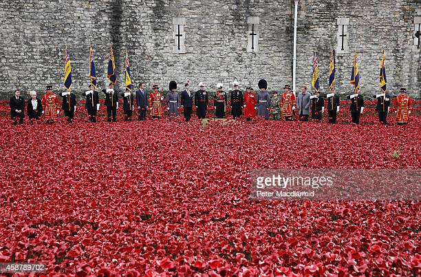 Sir Richard Dannatt Military cadet Harry Alexander Hayes and artists Tom Piper and Paul Cummins stand with yeoman warders veterans and dignitaries...