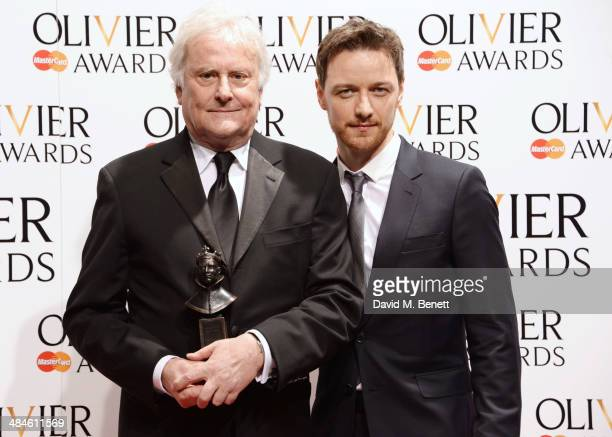 """Sir Richard Eyre , winner of the award for Best Revival for """"Ghosts"""" and presenter James McAvoy pose in the press room at the Laurence Olivier Awards..."""