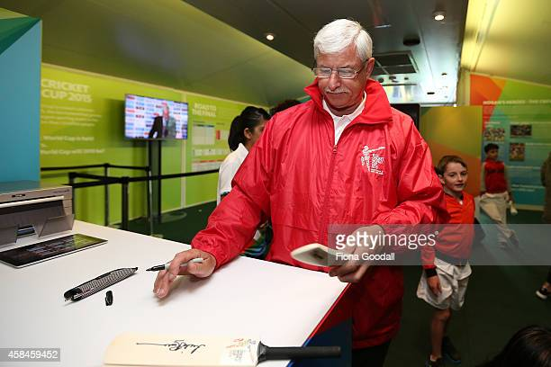 Sir Richard Hadlee signs mini cricket bats during the 100 day countdown to the 2015 ICC Cricket World Cup at Wynyard Wharf on November 6 2014 in...