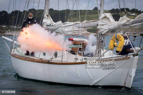 Sir Robin KnoxJohnston fires a cannon from his boat Suhaili to signal the start of racing for the competitors taking part in the 2018 Golden Globe...