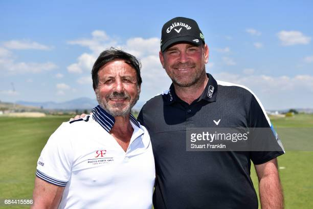 Sir Rocco Forte and Thomas Bjorn of Denmark participate in a golf clinic during the first round of the Rocco Forte Open at Verdura Golf and Spa...