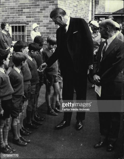 Sir Roden and Headmaster Mr JJ Taafe BA walking past a line of Boys and Girls from the SchoolThe Governor Sir Roden Cutler and Lady Cutler attended...
