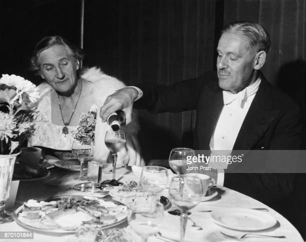 Sir Roderic Hill Rector of Imperial College London pours champagne for his wife Mabel at the College Union's Commemoration Ball October 1952