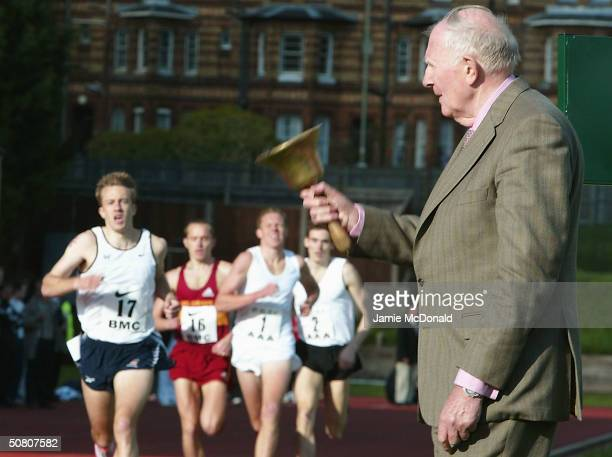 Sir Roger Bannister rings the Bell to signal the last lap of the mens elite 1500m race at the Iffley Road running track to celebrate the 50th...
