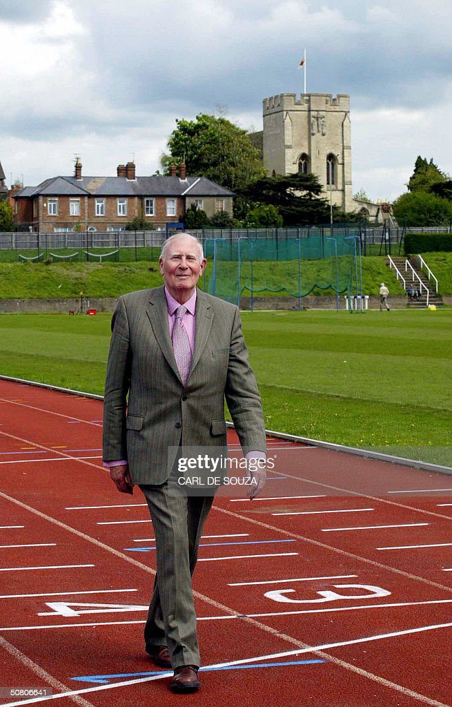 Sir Roger Bannister walks on the track where 50 years ago he broke the four minute mile at Oxford University in Oxford, England, 06 May, 2004. Fifty years ago today, Bannister, a tall English medical student thrust back his head and charged for the finishing line traced on a cinder running track in Oxford, breaking the four minute mile barrier with a time of 3:59.4.