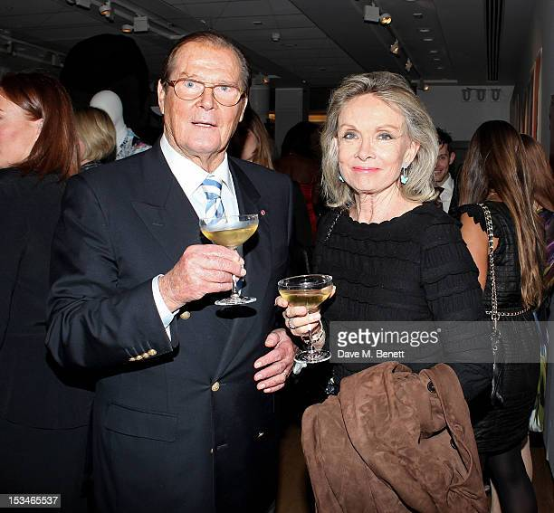 Sir Roger Moore and Christina Tholstrup attend '50 Years Of James Bond The Auction' celebrating the 50th anniversary of the film franchise and the...