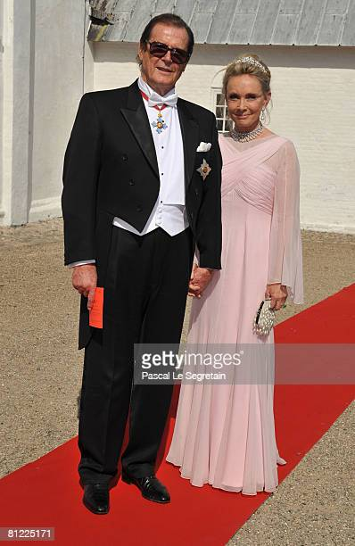 Sir Roger Moore and his wife Christina 'Kiki' Tholstrup arrive to attend the wedding between Prince Joachim of Denmark and Marie Cavallier on May 24...