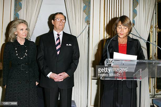 Sir Roger Moore and his wife Kristina Tholstrup French Culture Minister Christine Albanel in Paris France on October 28 2008