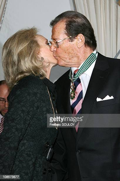 Sir Roger Moore and his wife Kristina Tholstrup in Paris, France on October 28, 2008.