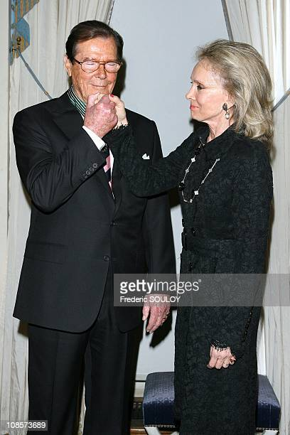 Sir Roger Moore and his wife Kristina Tholstrup in Paris France on October 28 2008