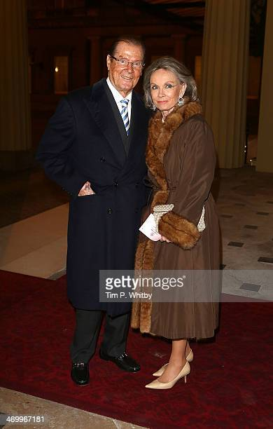 Sir Roger Moore and Kristina Tholstrup attend a Dramatic Arts Reception at Buckingham Palace on February 17 2014 in London England