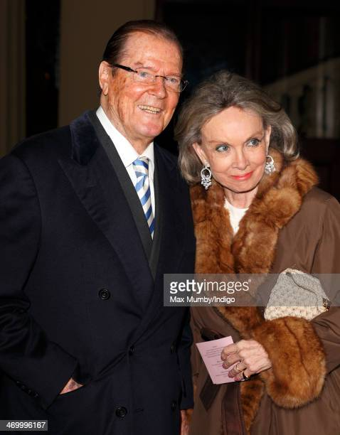 Sir Roger Moore and Kristina Tholstrup attend a Dramatic Arts reception hosted by Queen Elizabeth II at Buckingham Palace on February 17 2014 in...