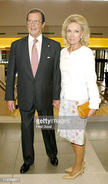 Sir Roger Moore and wife Christina Tholstrup at the British Library in London where the former Bond actor read aloud from Priness and the Pea Moore...