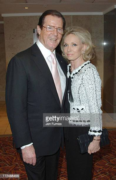 Sir Roger Moore and wife Christina Tholstrup during Sony Ericsson Empire Film Awards 2006 Inside at Cobden Club in London Great Britain