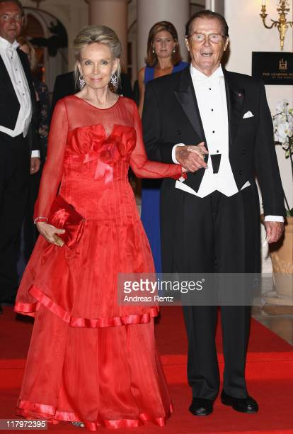 Sir Roger Moore and wife Kristina Tholstrup leave the Hotel Hermitage to attend a dinner at Opera terraces after the religious wedding ceremony of...