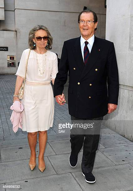 Sir Roger Moore pictured with his wife at the BBC on September 8 2014 in London England