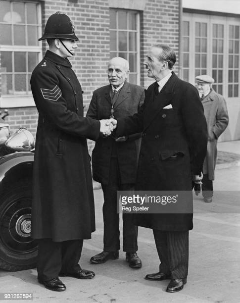 Sir Rupert De la Bère the Lord Mayor of London congratulates Sergeant W E Howes on his rescue work in Canvey Island in Essex which was badly affected...